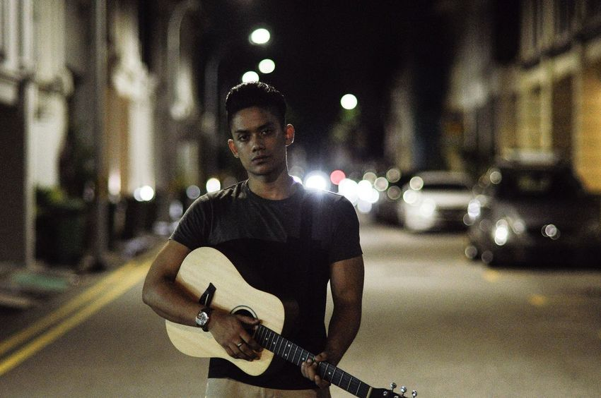 Guitar Night Music Musical Instrument One Person Arts Culture And Entertainment Adult Real People Playing Adults Only Outdoors Skill  Only Men Lifestyles Musician People Performance One Man Only Plucking An Instrument Acoustic Guitar Taylorguitars Humansofsingapore EyeEm Selects
