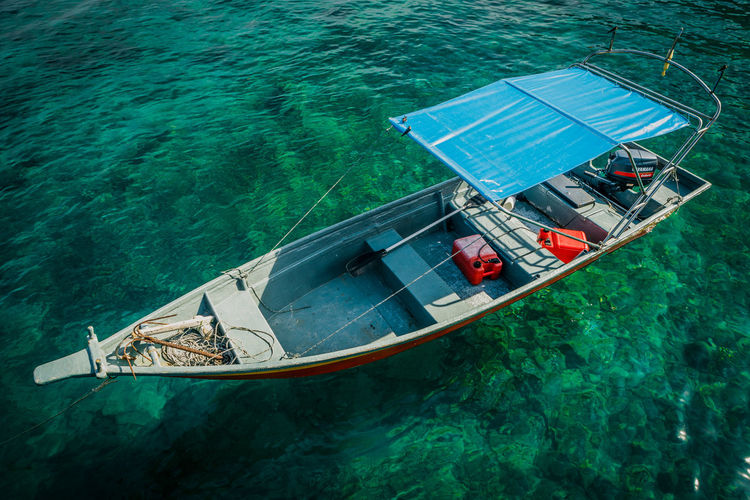Water taxi on clear tropical water Beach Clear Water Coral Island Resort Sunny Tioman Tropical Vibrant Color Water Water Taxi