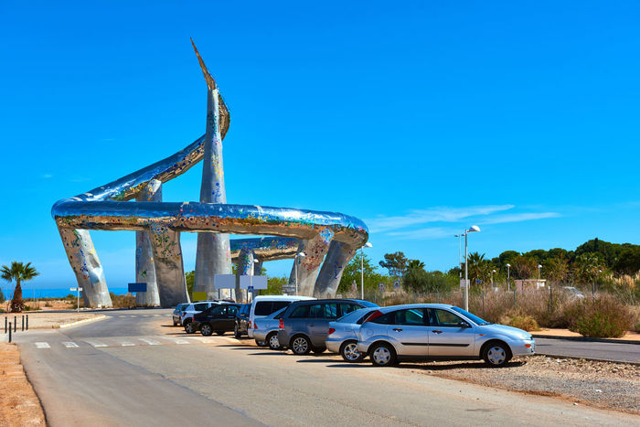 Sculpture at the entrance of Marina d'Or. Oropesa del Mar town. Province of Castellon. Spain Automobile Castellón City Europe Figure Landmark Marina D'or Mediterranean  Nobody Oropesa Oropesa Del Mar Outdoors Parking Lot Road Roadside Sculpture Sky SPAIN Sunny Day Symbol Town Transportation Urban