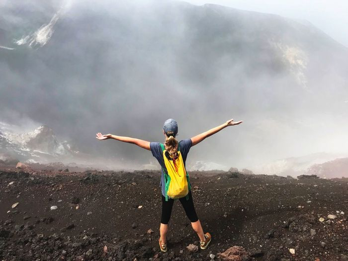 One Person Adventure Arms Outstretched Nature Hiking Vacations Full Length Extreme Sports Exploration Adrenaline Junkie Scenics Volcanic Crater Cerro Negro Nicaragua Volcanic Landscape Volcanic Rock Lava Field Determination Energetic Women Hiking Standing Landscape Crater Foggy Landscape