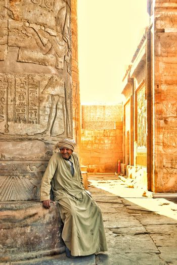 Architecture History Built Structure People Adult Building Exterior Outdoors Only Men One Man Only City Day One Person Adults Only Sky Temple Architecture Templephotography Komombo Luxor And Aswan Trip Landscape Sunny Tourism Photogtaphyinmotion EyeEm Best Shots Full Length Beauty In Nature