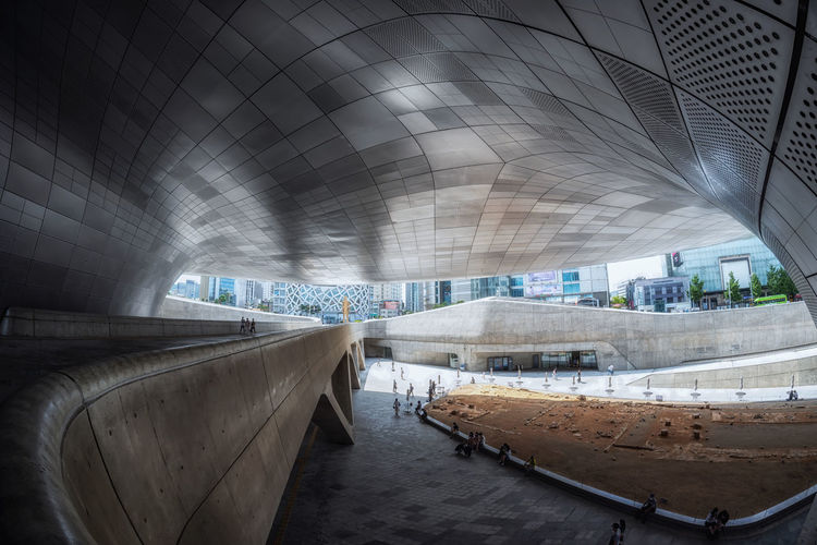 Dongdaemun design plaza taken with fisheye lens. a famous iconic landmark deisgned by zaha hadid.