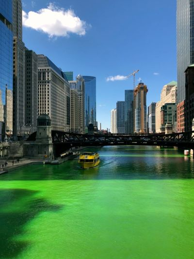 St patrick's day in Chicago Boat Chicago Building Exterior Architecture Built Structure City Water Building Urban Skyline Cloud - Sky No People Day Landscape Skyscraper Modern Outdoors City Life Cityscape Tall - High Architecture Architectural Column St Patrick's Day City Cityscape Landscape_Collection Urban Waterfront Travel Travel Destinations Travel Photography Tourism Tourism Destination