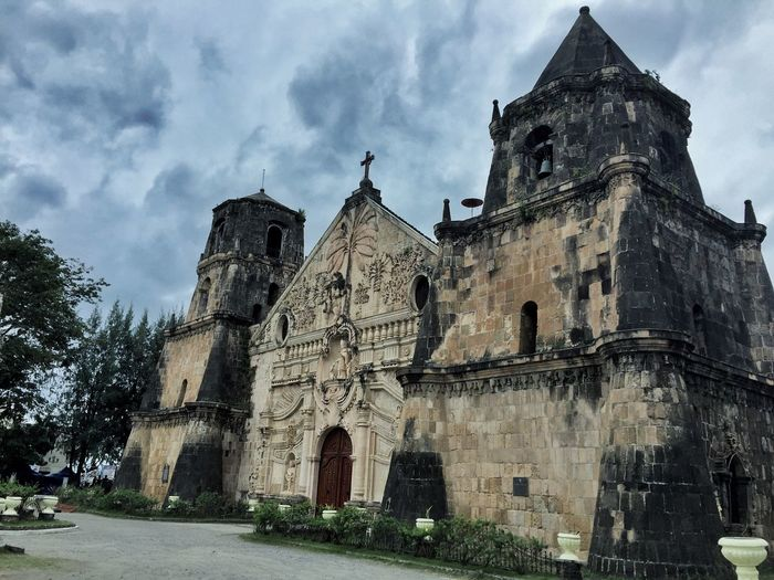 Church Of San Agustin Eyeem Philippines Iloilo City, Philippines Architecture Building Exterior Built Structure Cloud - Sky Day Façade History Low Angle View No People Outdoors Place Of Worship Religion Sky Spirituality Tree