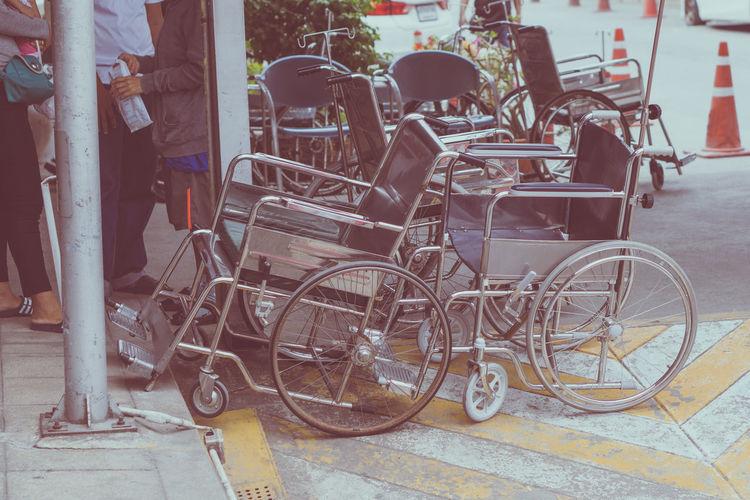 Bicycle parked on sidewalk by street