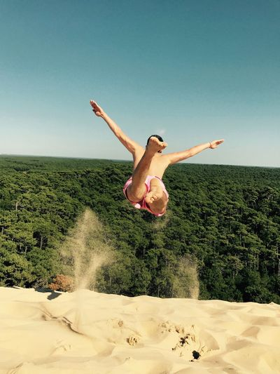 Life Is A Beach Mid-air Real People Jumping One Person Nature Day Beauty In Nature Lifestyles Fun Sky