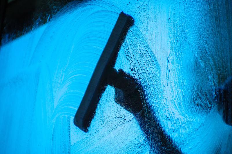 Close-up of person washing car