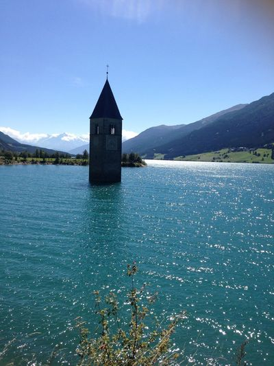 Tower reaching out from lake