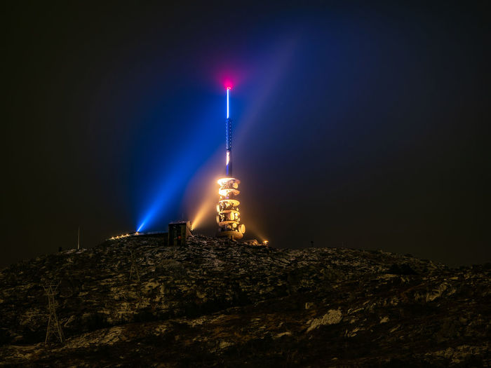 Ulriken through the clouds. Ulriken Ulriken643 Ulriken 643 Nightshot Night Illuminated Architecture Built Structure Building Exterior Building Guidance No People Tower Sky Nature Protection Rock Low Angle View Safety Rock - Object Copy Space Dark Outdoors Mountain