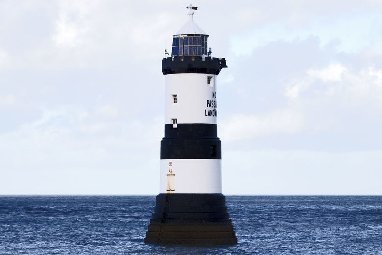 Sky Lighthouse Tower Guidance Sea Water Building Exterior Built Structure Security Protection Safety Horizon Horizon Over Water Architecture Direction Building Cloud - Sky No People Nature Outdoors Penmon Point