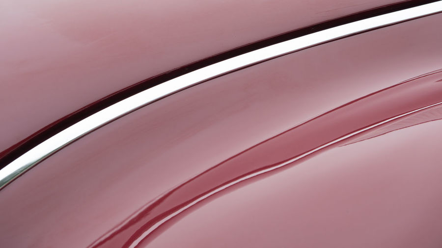Curved lines of a red oldtimer car Abstract Backgrounds Car Close-up Curve Curves Day Detail Full Frame Futuristic Lined No People Oldtimer Reflection Shiny Transportation