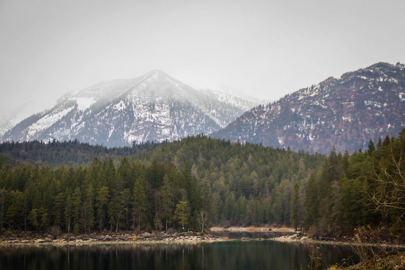 Mountain Scenics - Nature Tree Beauty In Nature Snow Land No People Nature Environment Water Plant Cold Temperature Sky Tranquil Scene Winter Snowcapped Mountain Tranquility Mountain Range Outdoors Mountain Peak Pine Tree Coniferous Tree