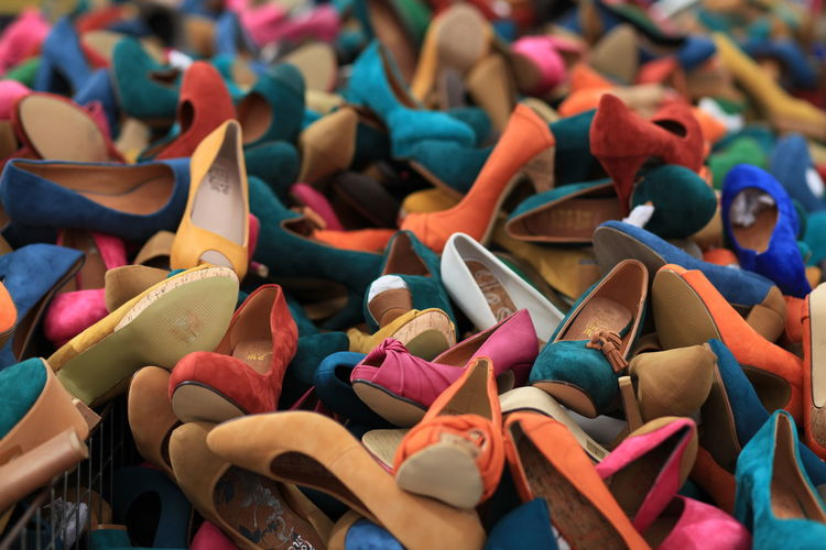 High angle view of various shoes for sale