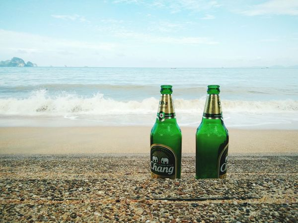 Sea Beach Water Horizon Over Water Food And Drink Beer - Alcohol Bottle Sand Green Color Drink No People Vacations Alcohol Sky Wave Day Outdoors Nature Freshness