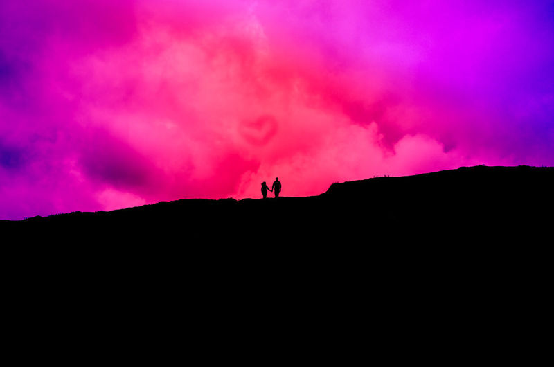 Couple Adventure Beauty In Nature Cloud - Sky Day Heart Hiking Landscape Leisure Activity Lifestyles Men Nature One Person Outdoors People Pink Blue Pink Blue Sky Real People Scenics Silhouette Sky Sunset Tranquility