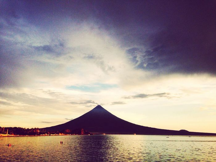A perfect Art Creation.. The Mt.Mayon Landscape Tranquility Scenics Sea Mountain Cloud Tranquil Scene Beauty In Nature Nature Ocean Water Waterfront Calm Cloud - Sky Mountain Range Town Remote Non-urban Scene No People Water Surface EyeEm Nature Lover Eyeem Philippines EyeEm Landscape Mayon Volcano Daraga, Albay Philippines Mayon