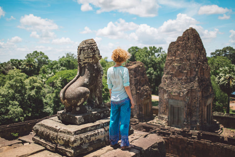 Siem Reap Cambodia Angkor Curly Hair Girl Sky Sculpture Day Architecture Statue Representation Nature Human Representation Creativity Cloud - Sky Art And Craft Travel Destinations Built Structure Tree Craft History Ancient Standing Plant Place Of Worship Outdoors Ancient Civilization Hairstyle A New Beginning A New Perspective On Life