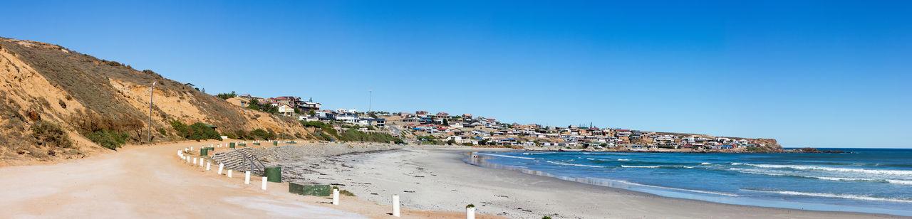 #beach #cliff #houses #sun  #ocean #poles #sunny #sunnyday #town #townscape #Waves