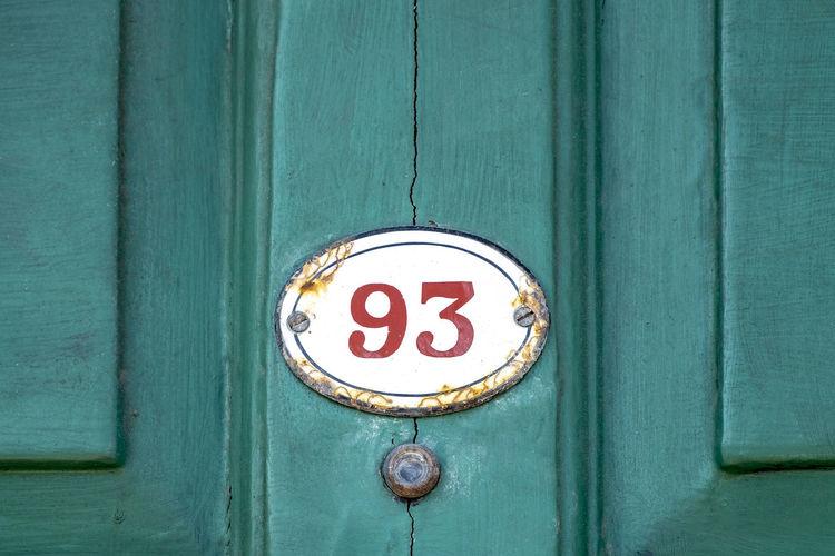 Close-up of numbers on wooden door