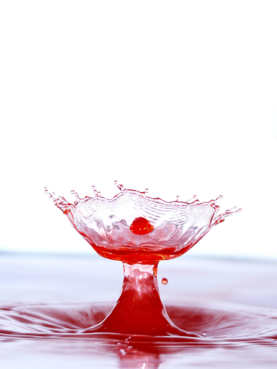 studio shot, red, white background, no people, close-up, motion, high-speed photography, water, freshness, day