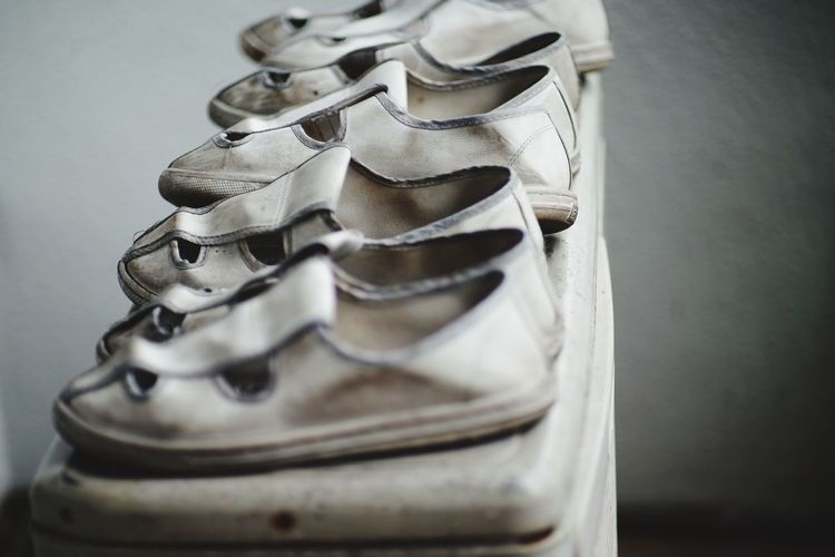 High angle view of old shoes on table