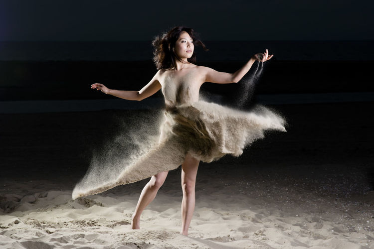 Dress of sand, created with the finest dutch sand during an evening session on the beach. Model: Miya Sato (Model Mayhem # 3559858) Ballet Beautiful Woman Black Background Black Background Ephemeral Girl Model Moment Momentarily People Person Transient Transitory Unreal Woman Dancing Dark Dress Of Sand Ephemeral Fashion Grace Model Moment Momentarily Night Nightphotography One Person People Performance Performing Arts Event Sand Transient Vitality First Eyeem Photo The Fashion Photographer - 2018 EyeEm Awards