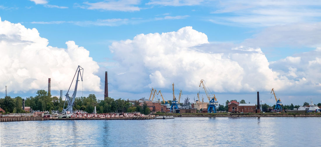 Panoramic view of harbor against sky