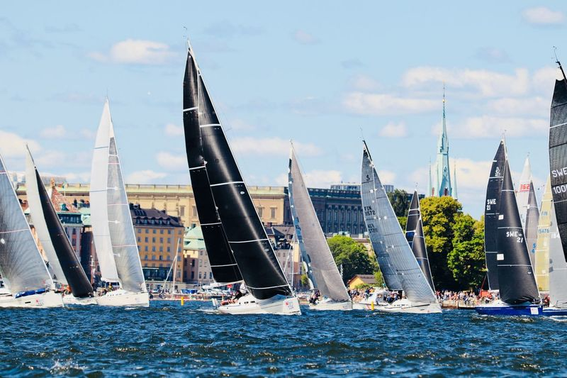 Sailboat Regatta While in Stockholm we witnessed an international sailboat regatta. There more than 100 large sailboats from around the globe competing. Here some of them are leaving the harbor in preparation for the competition. The Traveler - 2018 EyeEm Awards The Street Photographer - 2018 EyeEm Awards Competitive Sport Regatta Sailing Architecture Water Built Structure Building Exterior Sky Nautical Vessel Waterfront City Transportation Cloud - Sky Nature Travel No People Travel Destinations Mode Of Transportation Sailboat Outdoors