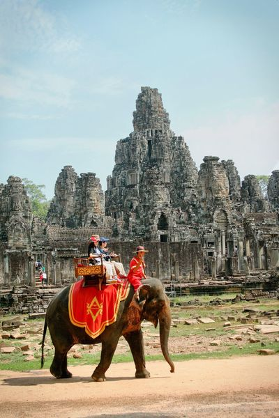 Bayon Temple Angkor Thom Angkorarcheologicalpark Travel Destinations Elephant Old Ruin Travel Ancient Tourism Riding Tourist Domestic Animals Full Length Real People Sky History Outdoors Canonphotography Working Animal Place Of Worship Vacations Architecture Mammal Temple in Cambodia Neighborhood Map Second Acts An Eye For Travel