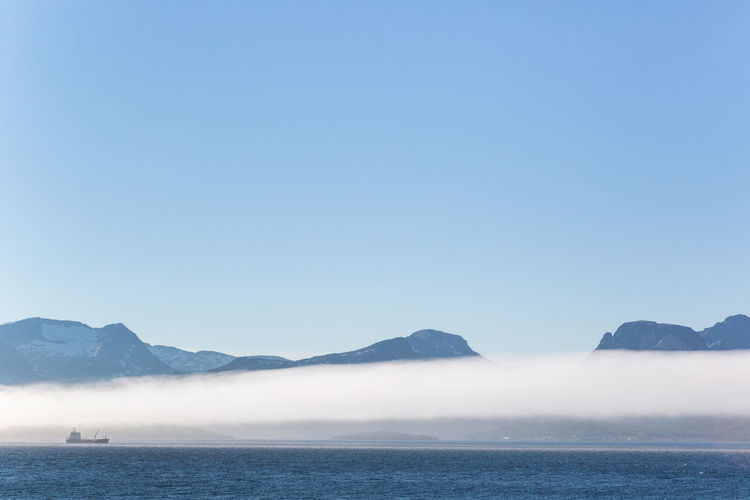 Ship in the fog Blue Blue Sky Clear Sky Copy Space Copy Space Distant Fjord Fog Horizon Over Land Landscape Mountain Mountain Range Nature Northern Norway Scenics Ship Vacation Vacations Water Waterfront Simplicity Showcase: February Pastel Power Landscapes With WhiteWall