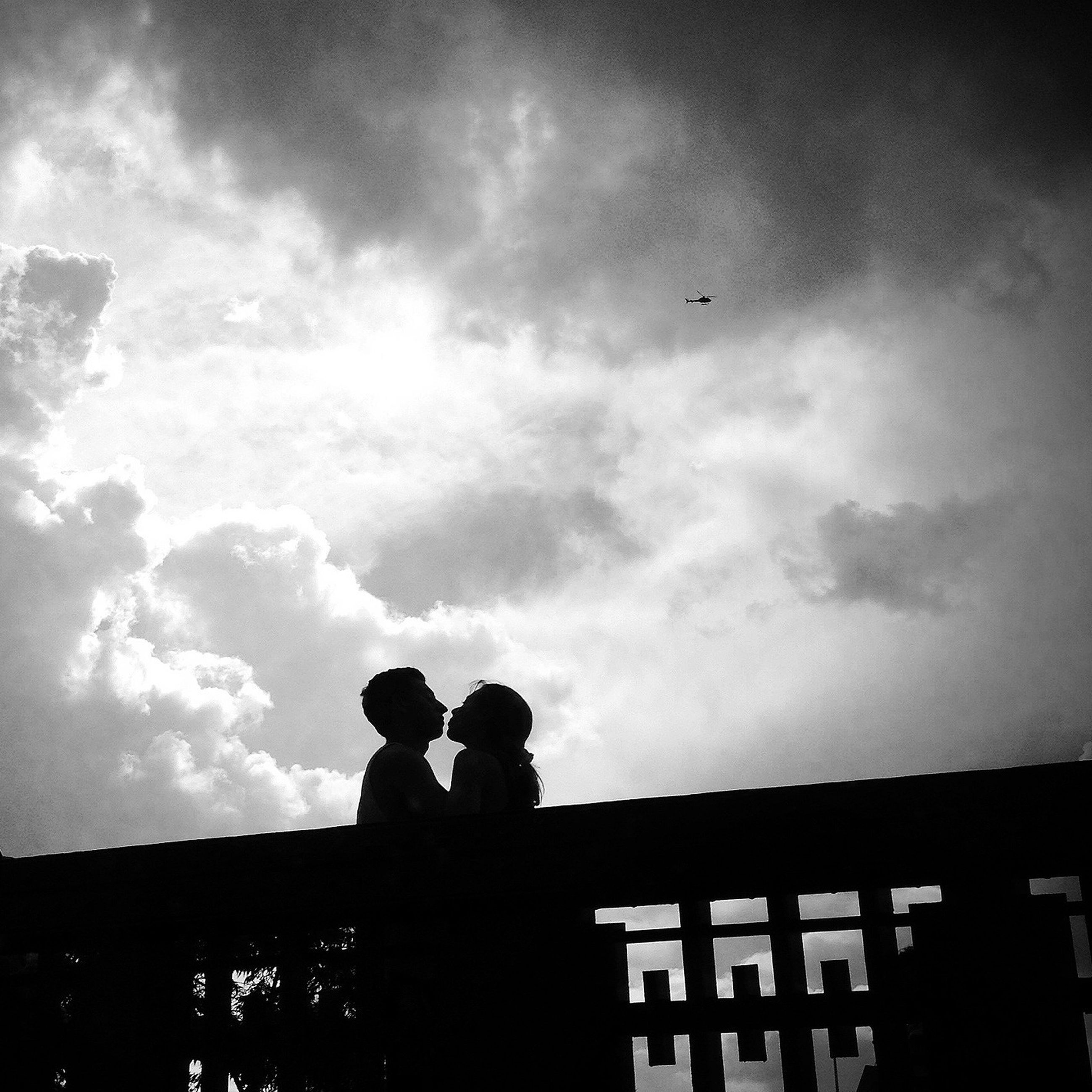 silhouette, sky, men, lifestyles, togetherness, cloud - sky, leisure activity, low angle view, bonding, cloudy, person, outline, standing, boys, childhood, cloud, love