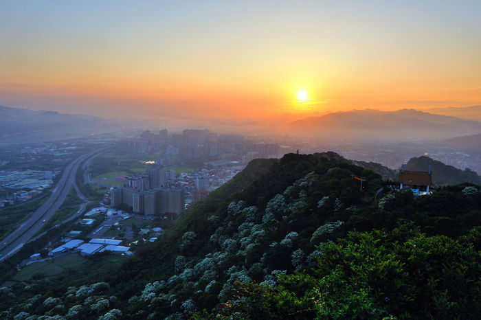 Early morning sun, full of warm hope. Beautiful City Taiwan's New Taipei City Fugueijiao Lighthouse Architecture Beauty In Nature Building Exterior Built Structure City Cityscape Dawn Day Growth High Angle View Morning Fog Mountain Nature No People Outdoors Scenics Sky Sunrise Sunset Tree Tung Blossom Warm