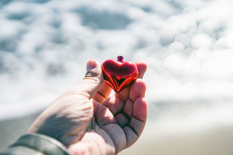 Close-up of hand holding heart shape