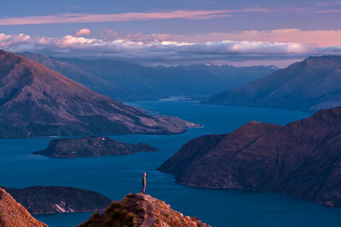 That famous view at Roy's Peak Track right after sunrise. South Island of New Zealand Wanaka Beauty In Nature Day Girl Idyllic Instagram Lake Wanaka Leisure Activity Lifestyles Mountain Mountain Range Nature New Zealand One Person Outdoors People Real People Roys Peak Scenics Sea Sky Sunrise Tranquil Scene Tranquility Water My Best Travel Photo