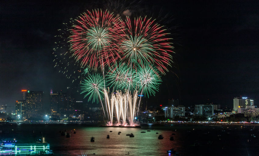 Firework display in city at night