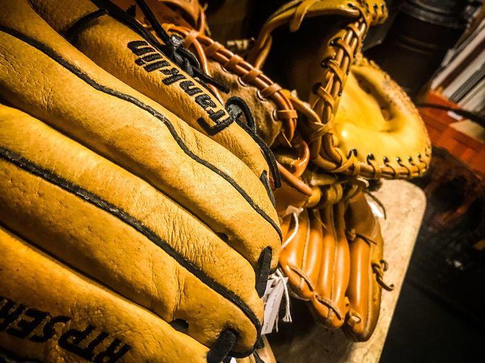 Baseball gloves on table