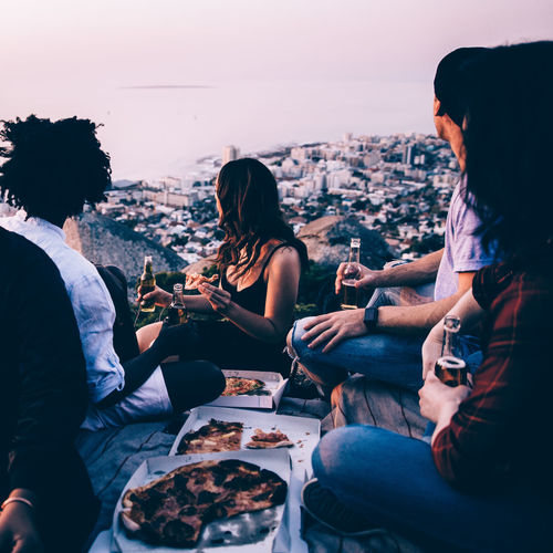 Afro Alcohol Alcoholic Drink Beer Cape Town Celebration Cheerful Drink Enjoyment Friends Friendship Fun Group Of People Happiness Lifestyles Night Party Party - Social Event People Picnic Pizza Pizza Box Smiling Social Gathering Sunset