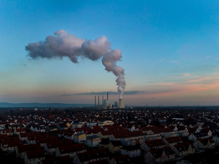 powerplant Building Exterior Smoke - Physical Structure Pollution Smoke Stack Architecture Factory Built Structure Sky Emitting Environmental Issues Industry Environment Fumes Chimney Smoke Atmospheric Nature City No People Chemical Air Pollution Ecosystem  Outdoors Cityscape