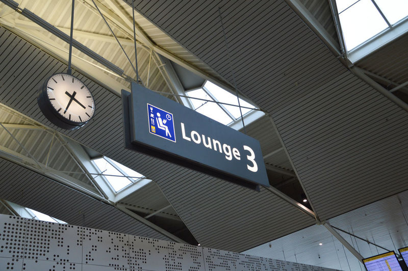 Schiphol Airport Lounge Sign Netherlands Schiphol Sign Board Clock Communication Direction Directions Indoors  Information Sign Lounge No People Text