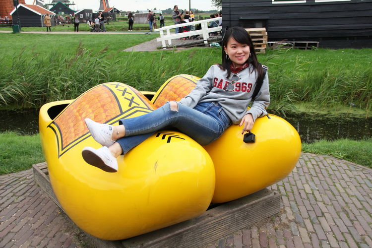 Casual Clothing Cheerful Child Childhood Day Emotion Enjoyment Front View Full Length Fun Happiness Inflatable  Innocence Leisure Activity Looking At Camera One Person Outdoors Plant Portrait Sitting Smiling