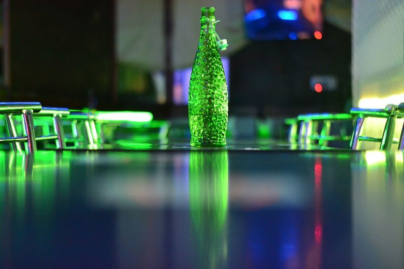 Close-Up Of Beer Bottle On Table In Bar
