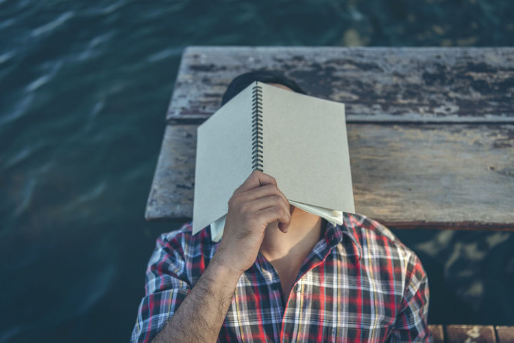 Low section of person holding book