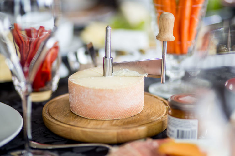 Cheese With Slicer On Cutting Board