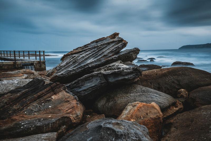 Rocks on shore at beach