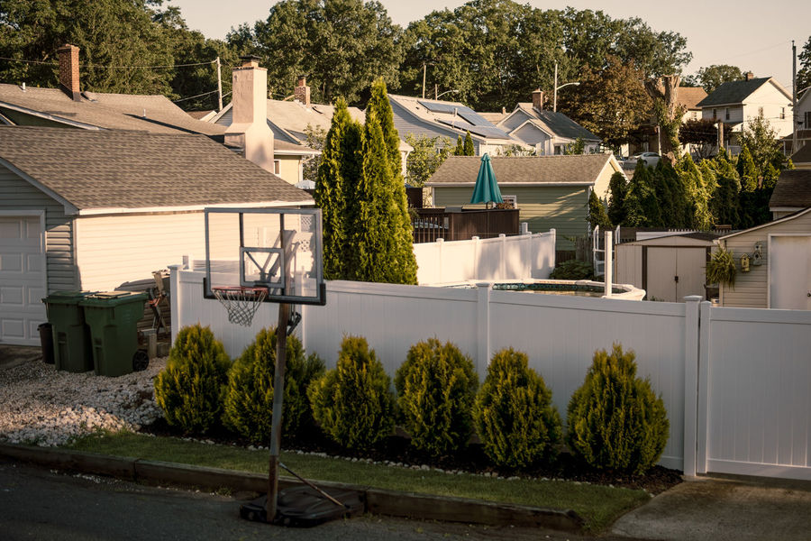 Suburbia Architecture Building Building Exterior Built Structure City Day Front Or Back Yard Green Color Growth Hedge House Nature No People Outdoors Plant Residential District Roof Sky Suburbia Sunlight Travel Destinations Tree