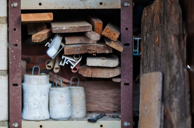 Wooden planks and work tools on metallic shelf