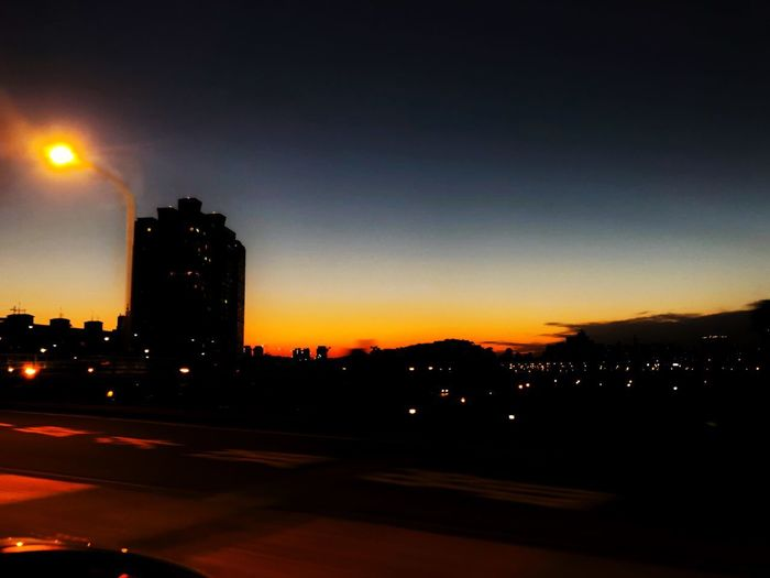 Night sky Sky City Illuminated Building Exterior Architecture Sunset Silhouette Car Night No People City Life Road Building Nature