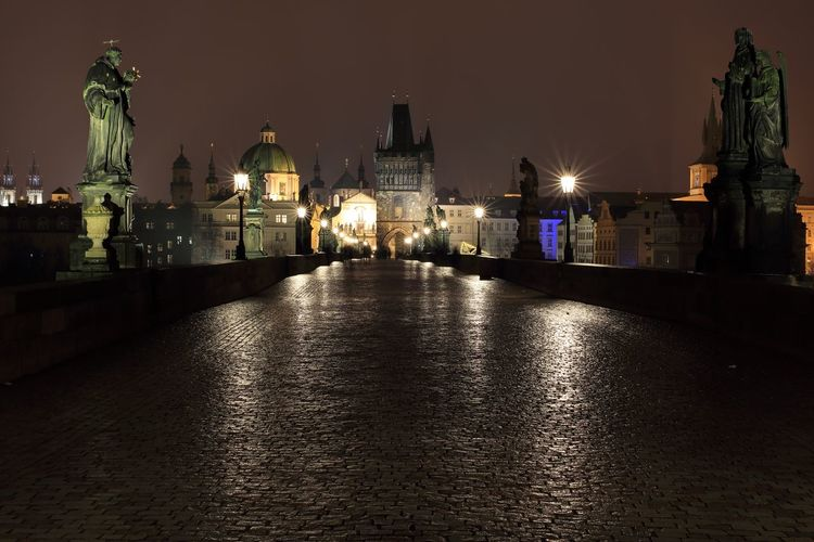 Illuminated charles bridge in city at night