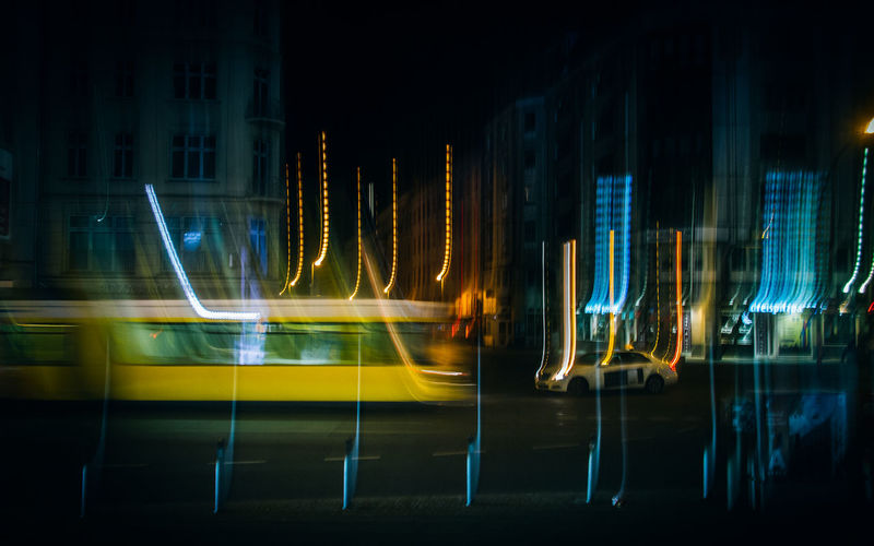 Light Trails And Vehicles On Road At Night