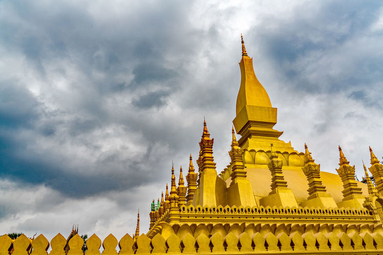 Pha That Luang pagoda, the national monument of Laos in Vientiane Buddhist Travel Vientiane Architecture Buddhism Built Structure Cloud - Sky Culture Day Gold Gold Colored Heritage History Laos Laos Travel Low Angle View No People Outdoors Pagoda Pha That Luang Place Of Worship Religion Spiritual Spirituality Travel Destinations